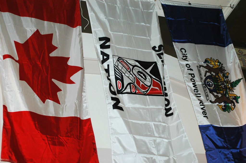 Canadian, Tla'amin, and Powell River flags