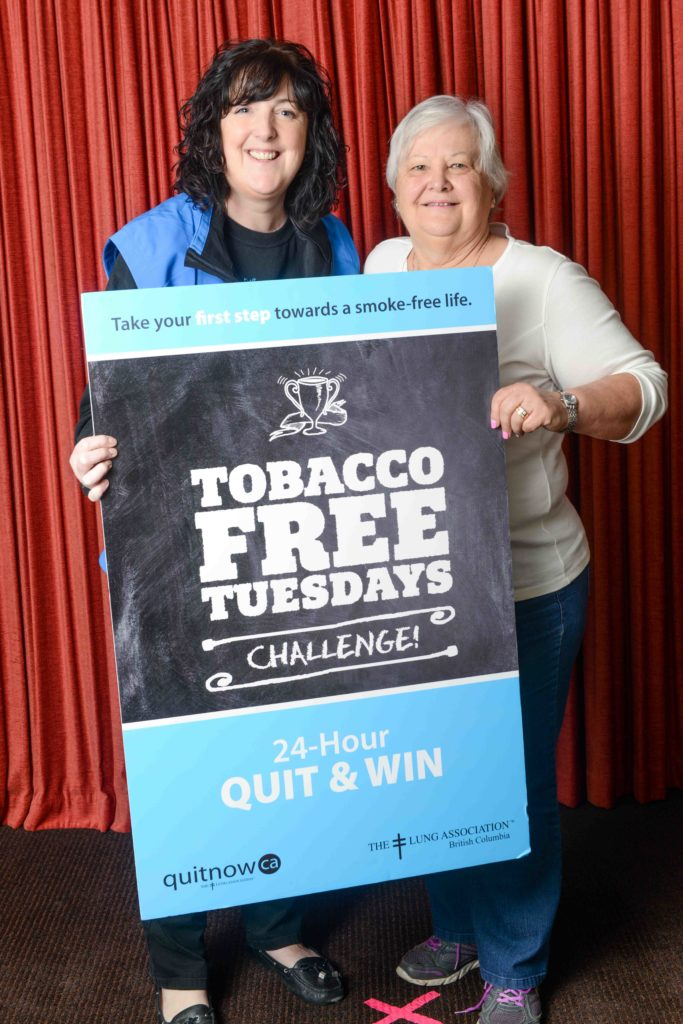 Judy Logan, BC Lung Association Volunteer Director with QuitNow's Louise Mott encourages Powell River citizens who smoke to commit to quit for 24 hours for a chance to win $250.