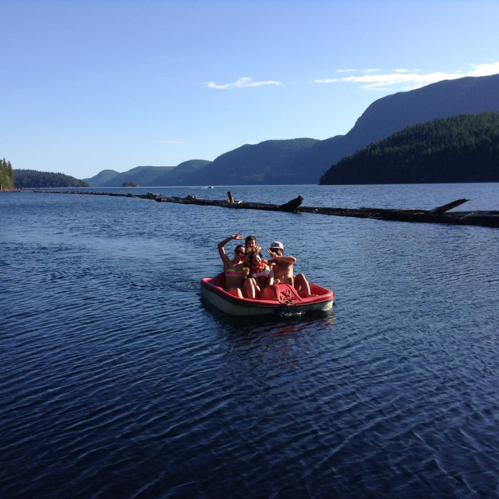 Our grandkids pedal-boating on Powell Lake with their Auntie and Uncle / Photo: Barbara Behan
