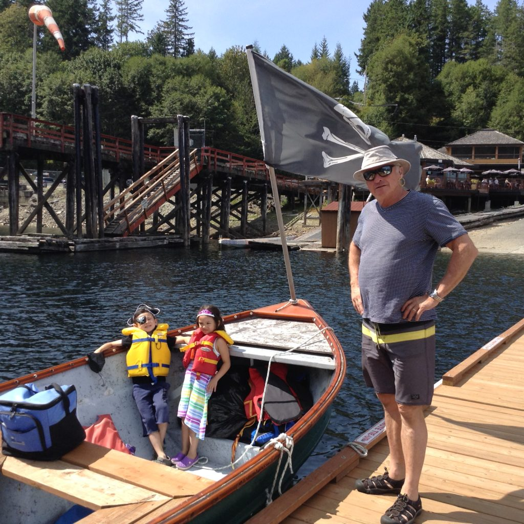 """The kids playing pirates with their Grandpa as we head """"up the lake"""""""