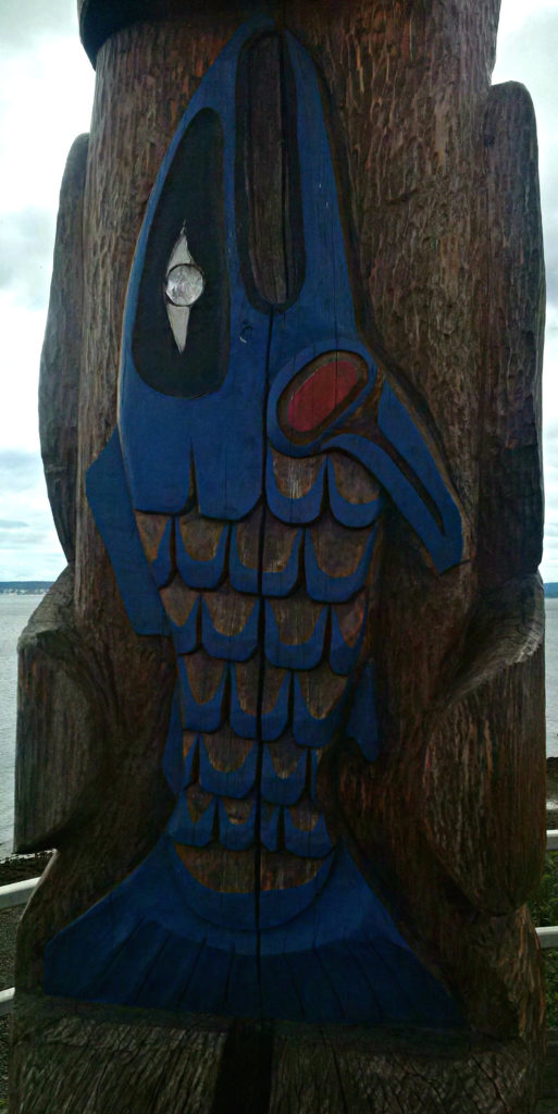 Hereditary Hagoos Totem Pole designed and carved by Master Carver Jackie MukSamma Timothy of the Tla'Amin First Nation.